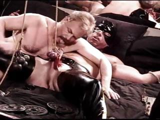 CBT muscle bear bottom is restrained and then subjected to testicle punishment.