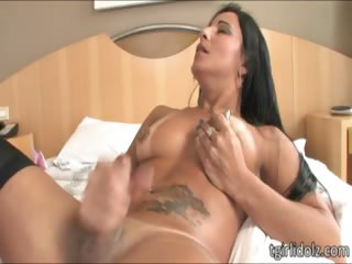 Pierced nippled shemale strokes her cock