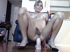 Gurl pushes a huge dildo up her she-creature hole and rides it